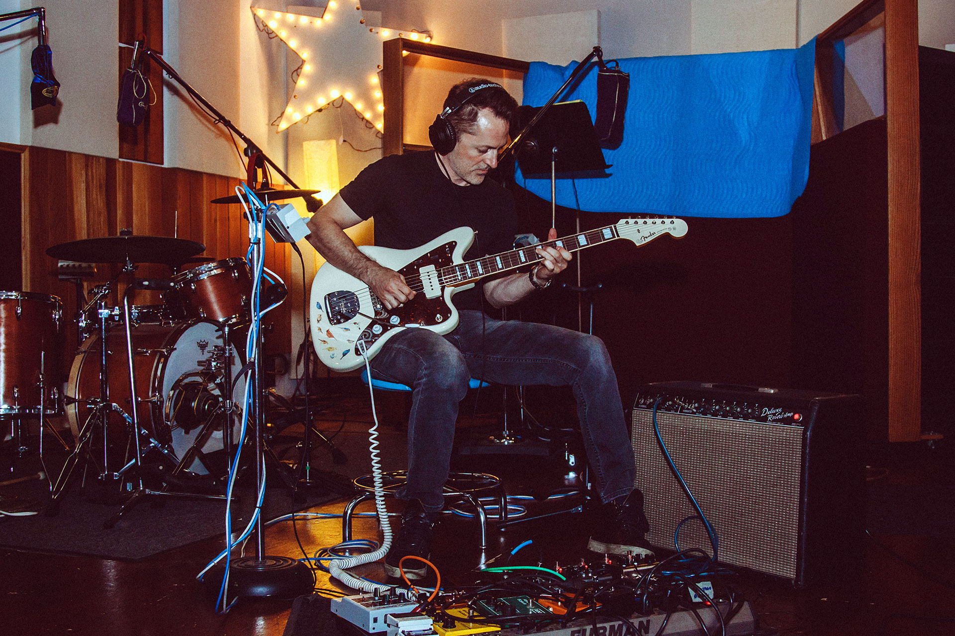 Stephen Becker playing the electric guitar
